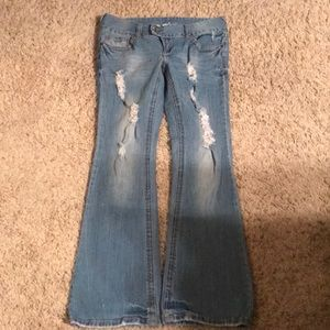 Jeans by rue 21.  Selena style.   Factory holes